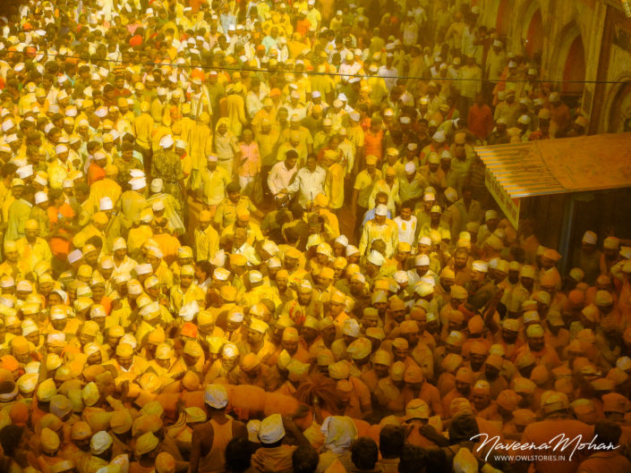 Huge crowd at Khandoba Temple. Turmeric being thrown from rooftops on the huge crowd