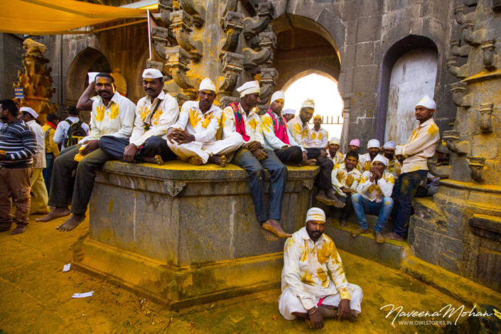 People relaxing at Khandoba Temple