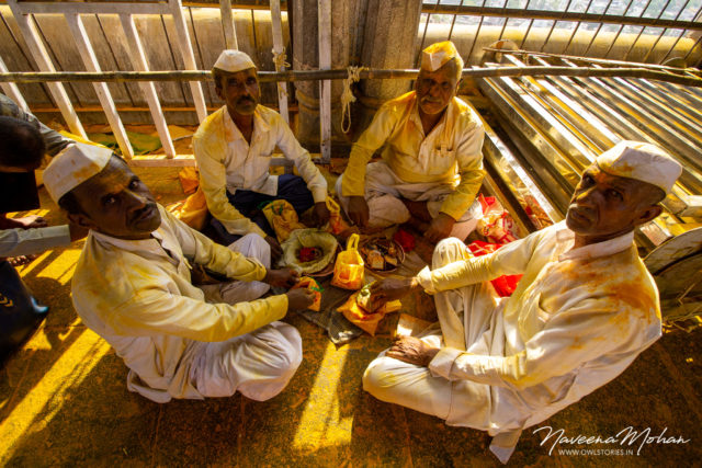 Khandoba temple. People taking a break